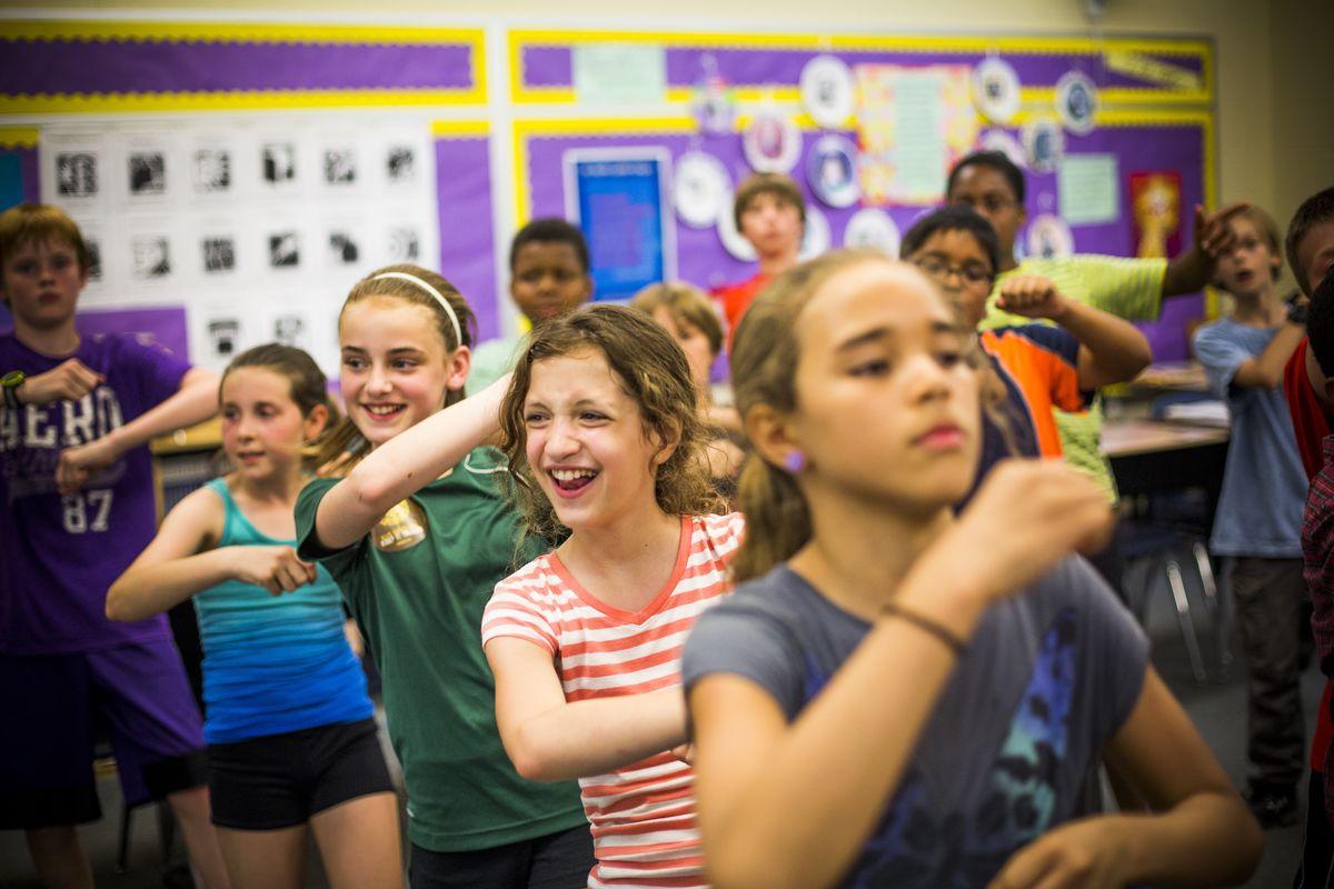 Kids dancing in a classroom
